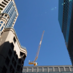 Crane setup between skyscrapers